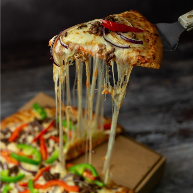 stretchy cheese on a spicy beef and mixed pepper pizza